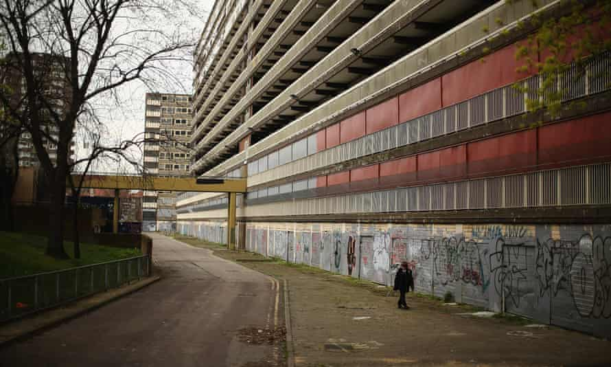 Demolition and displacement … a boy walks through the condemned Heygate Estate in London in 2013.