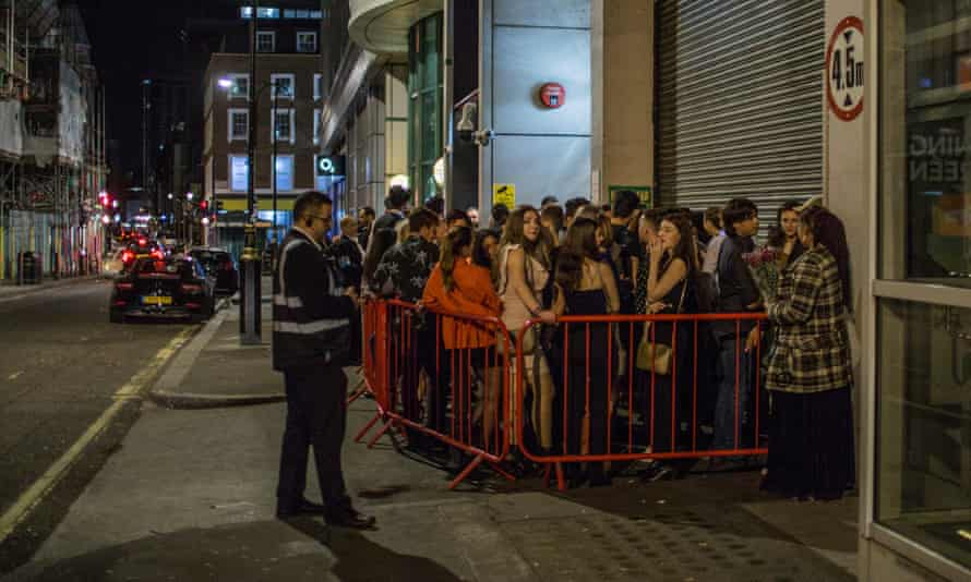 Clubbers queueing outside Scandal near London's Oxford Circus.