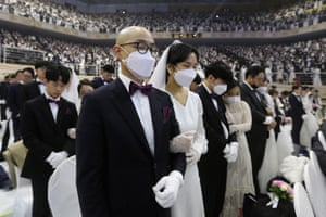 Couples pray during the ceremony