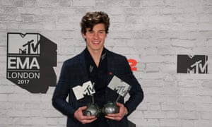 Shawn Mendes poses with two of his gongs.