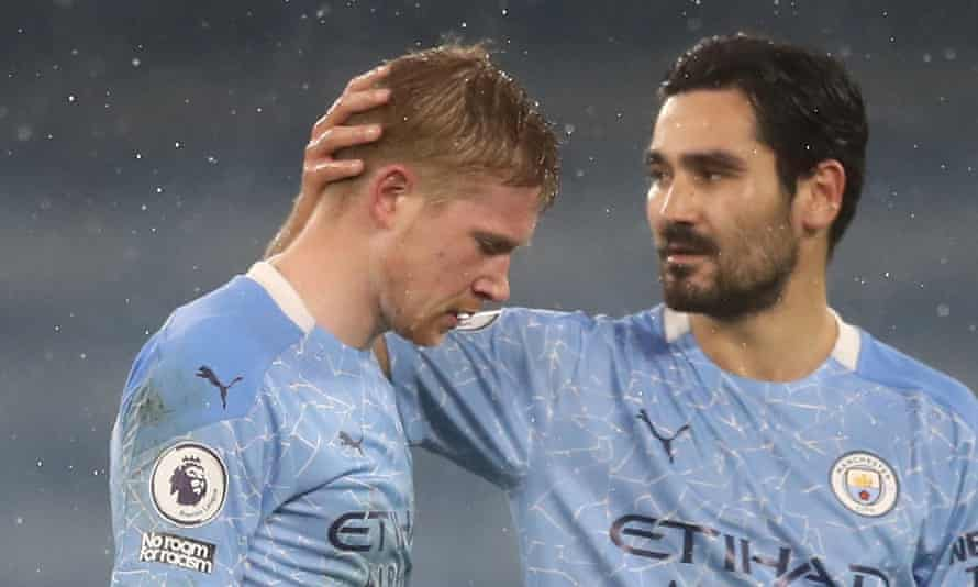 Kevin De Bruyne is consoled by Ilkay Gündogan after being injured and substituted against Aston Villa.