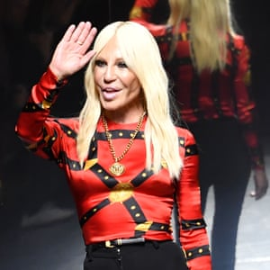 Donatella Versace greets the audience after the show.