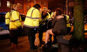 Members of the Manchester Street Angels call a young woman's father in order to help her get home from Deansgate Lock.