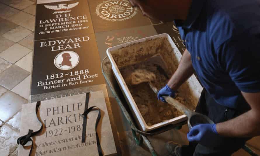 Westminster Abbey stonemasons prepare the permanent memorial to poet Philip Larkin.