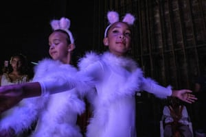 Dancers wait in the wings during a dress rehearsal