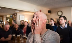 Leicester gather in the pub to watch their team play Arsenal.