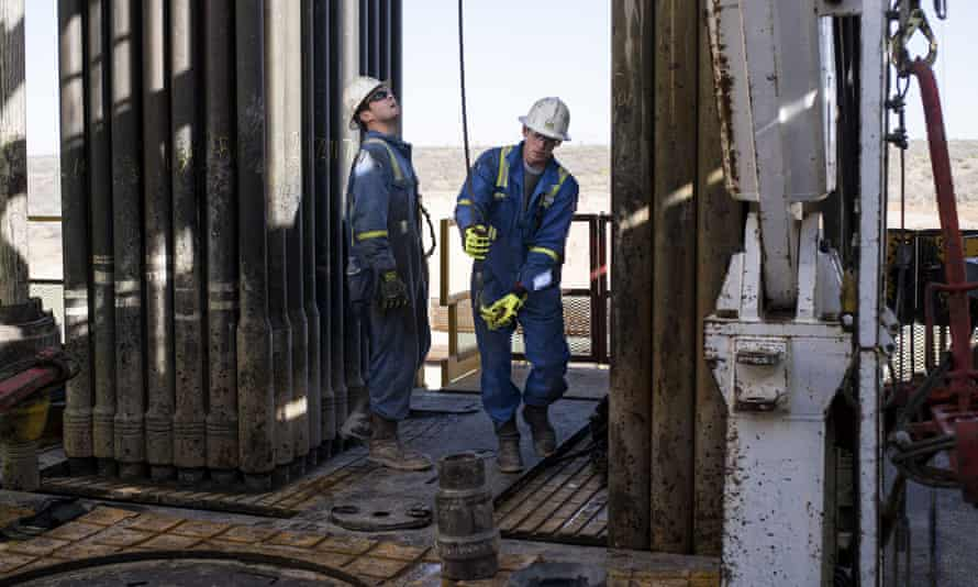 Royal Dutch Shell rig operators in Texas. Oil and gas companies have been told they could be downgraded between one and two notches as S&P increases risk rating for the entire sector.