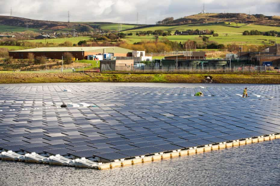 The new floating solar farm being grid connected on Godley reservoir in Hyde, Manchester, UK.