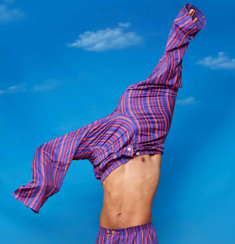 Man wearing one pair of pyjama bottoms and pulling another pair on over his head