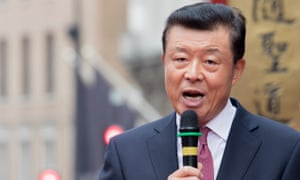 Liu Xiaoming speaking into a microphone