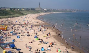 Bathers at Long Sands beach in Tynemouth, north-east England