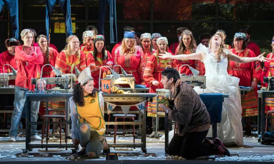 Aoife Miskelly (in yellow) in the title role with Phillip Rhodes (Mizgir) and Elin Pritchard (Kupava) and the Chorus of Opera North in The Snow Maiden.