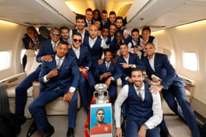 The Portugal players pose with the Euro 2016 trophy and a picture of the late Eusebio during the return flight to Lisbon