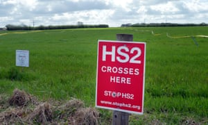 Protest signs mark a field site where the HS2 railway is planned near Lymm, west of Manchester