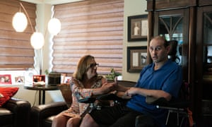 Sherrie Rubin and her son Aaron in the living room in their family home in Escondido.