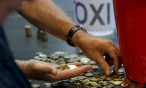 Donations are counted following a collection for the Greek Solidarity Campaign in London.