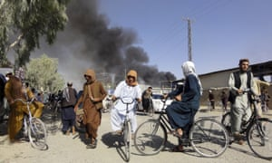 Smoke rises after fighting between the Taliban and Afghan security personnel in Kandahar on Thursday.