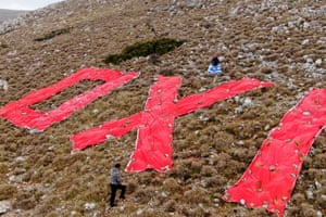 Chios, Greece. Residents have fixed banners made of cloth to a mountain slope in protest against the creation of a new refugee and migrant facility on the island. The cloth letters read 'no'