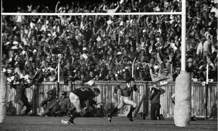 JJ Williams celebrates after scoring the first of his two tries past a despairing Hannes Marais, the South African captain, at Boet Erasmus Stadium in Port Elizabeth on 13 July 1974