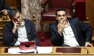 Greece's Prime Minister Alexis Tsipras, right, and Finance Minister Euclid Tsakalotos at last night's parliamentary vote.