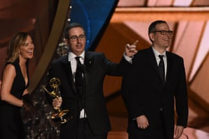 Writer/producer Tim Carvell (R) and TV host John Oliver (C) accept Outstanding Variety Talk Series for Last Week Tonight with John Oliver.