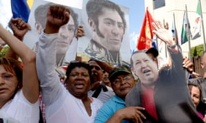 Socialist party supporters hold pictures of Chávez and Simón Bolívar outside the supreme court