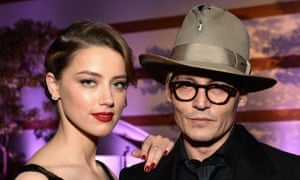 Amber Heard and Johnny Depp in Los Angeles in 2014. Heard filed for divorce in May and obtained a temporary restraining order.