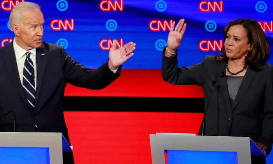 Joe Biden and Kamala Harris gesture on the second night of the second Democratic debate in Detroit, in July.