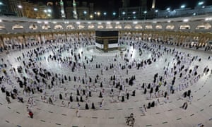 Muslim pilgrims move around the Kaaba, Islam's holiest shrine