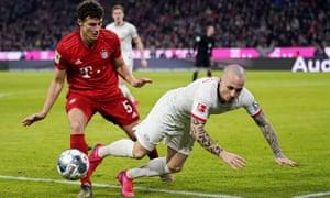 Bayern Munich's Benjamin Pavard (left) tangles with Leipzig's Jose Angelino