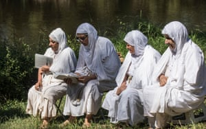 Women read holy scripts after being baptised.
