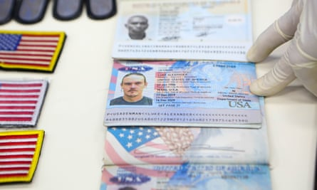 Personal documents allegedly belonging to US 'mercenaries' are shown displayed at Miraflores Palace in Caracas.