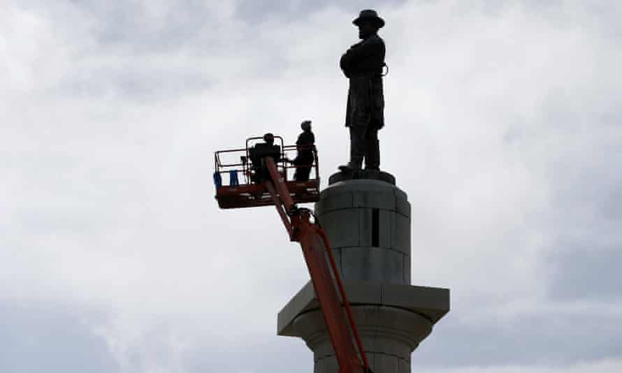 The statue of Robert E Lee will be taken down from atop a 60ft pedestal, where it has been since 1884.