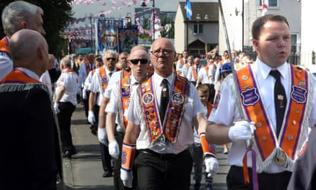 Orangemen take part in the annual 12 July parade in Belfast. The Orange Order says faith alone can get a person to heaven.