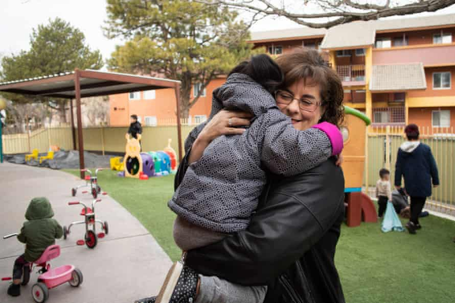 Joanna Rubi, an Albuquerque foster parent, hugs her foster child. She estimates that about a third of the nearly 200 children she has taken in have been short stays.