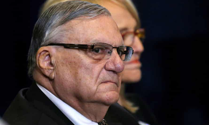 Sheriff Joe Arpaio is pictured waiting for Donald Trump during a campaign event in Phoenix, Arizona.