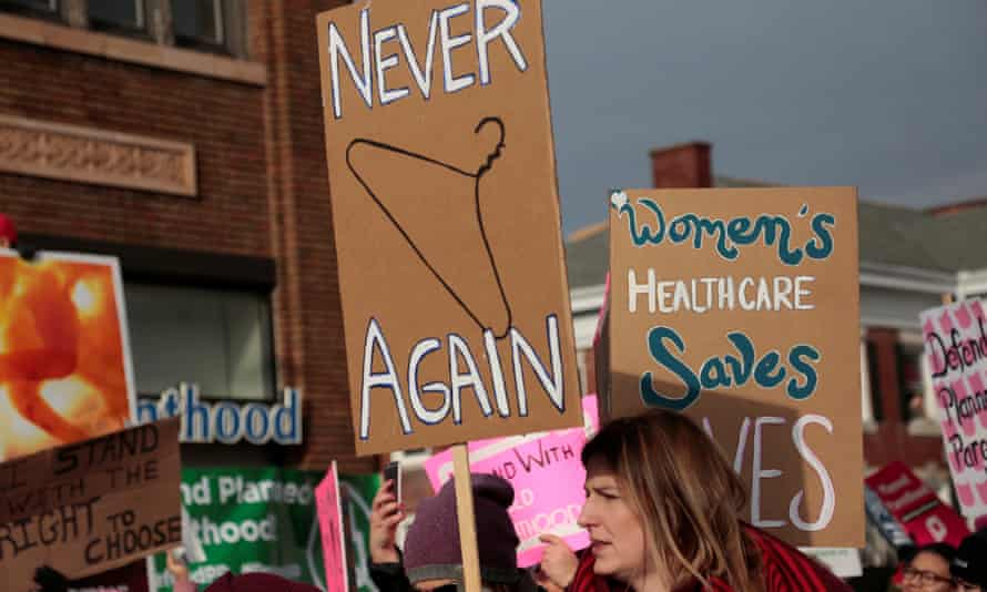 Supporters of Planned Parenthood rally outside a clinic in Detroit, Michigan.