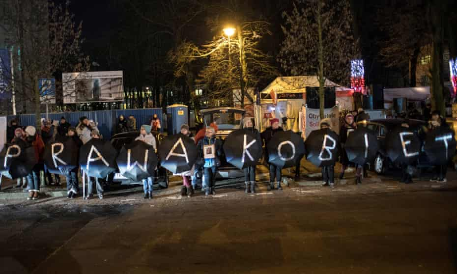 Protesters spell out the phrase 'women's rights' in Polish at a rally outside parliament in Warsaw