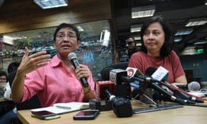 Maria Ressa (L) has vowed she will continue to fight as president Rodrigo Duterte seeks to shut Rappler down