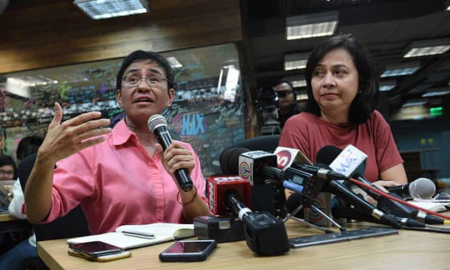 Maria Ressa (L) has vowed she will continue to fight as president Rodrigo Duterte seeks to shut Rappler down
