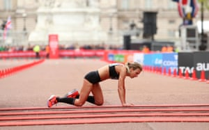 Great Britain's Hayley Carruthers crawls across the finish line after running a personal best