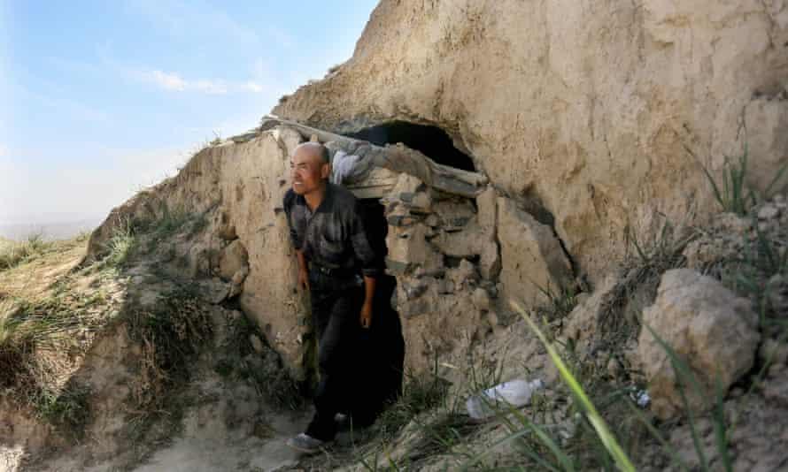 Zhu Keming outside the cave.