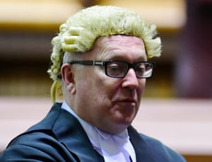 Federal attorney general George Brandis is seen at the swearing-in ceremony of Justice Michelle Gordon at the High Court of Australia, 9 June 2015.