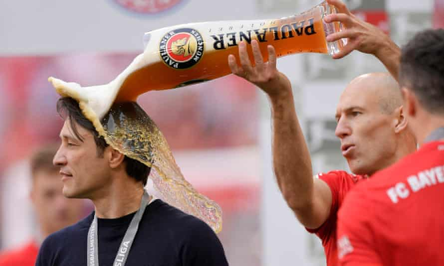 Arjen Robben douses his manager Niko Kovač in beer after playing his final game for Bayern Munich.