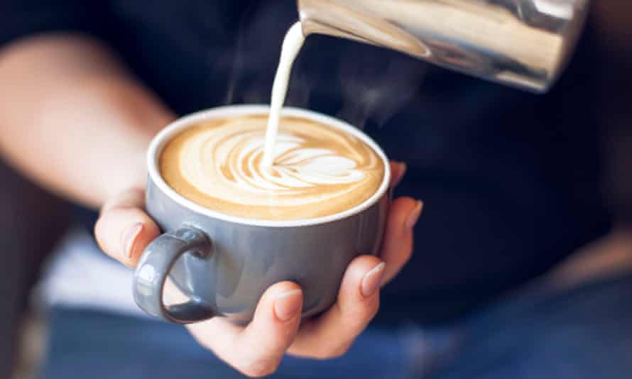 a man pours a frothy coffee