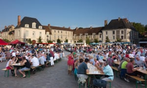 People attending a food festival in the main square at Richelieu in the Loire Valley