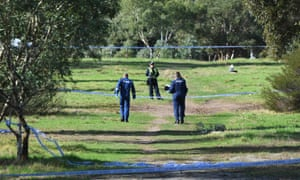 Forensic investigators enter the crime scene