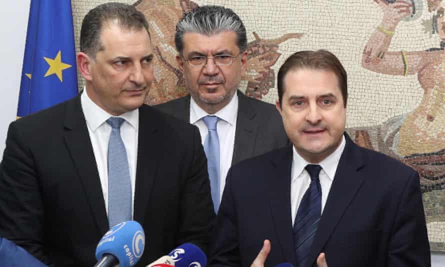 Energy minister Yiorgos Lakkotrypis, the energy ministry's Stelios Himonas and ExxonMobil's Tristan Aspray