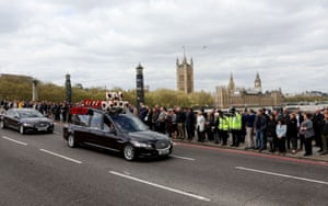 The hearse crosses Lambeth Bridge en route to Southwark Cathedral