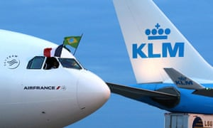 Two planes with the KLM and the air France logos sit side by side